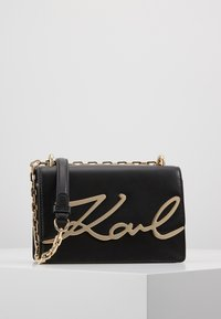 KARL LAGERFELD - SIGNATURE SMALL - Across body bag - black/gold-coloured - 0