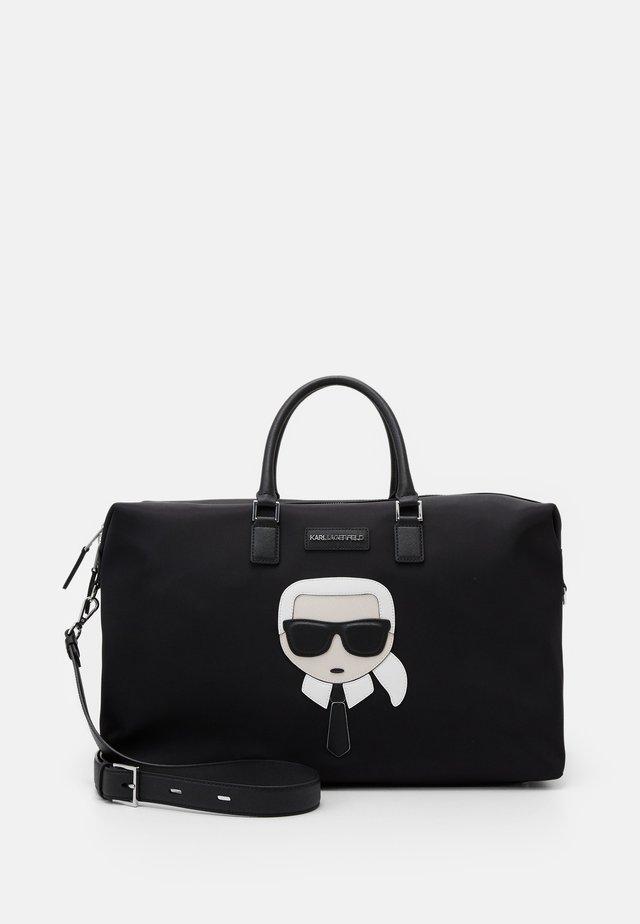 IIKONIK WEEKENDER - Weekend bag - black