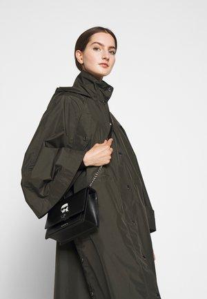 IKONIK LOCK - Handbag - black