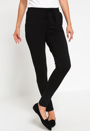 LINDA  - Tracksuit bottoms - black deep