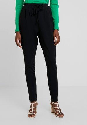 KAJOJO STRING PANTS - Trousers - black deep