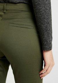Kaffe - KAJANAH PANTS - Trousers - grape leaf - 6