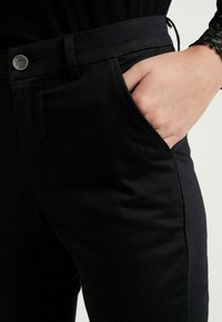 Kaffe - KAJANAH PANTS - Trousers - black - 4