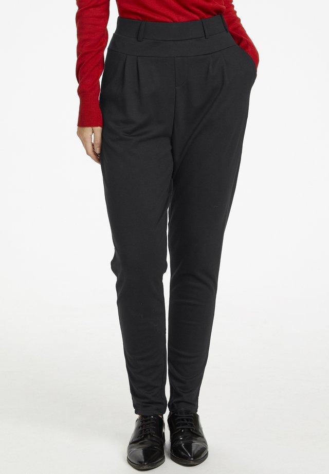 KAJULIANE - Trousers - black