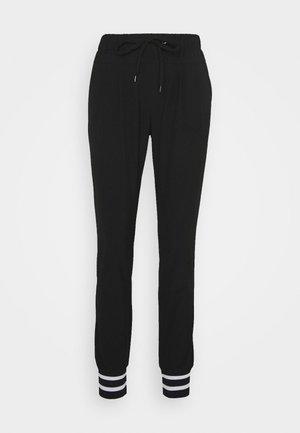 KAJOA PANTS - Trousers - black deep