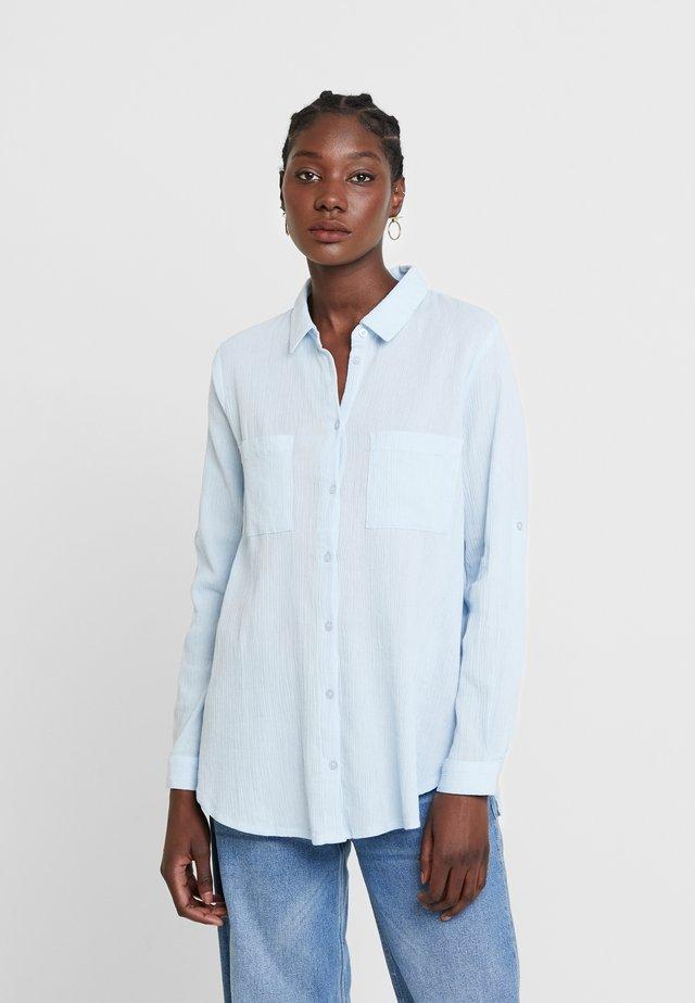 REGINA - Button-down blouse - light blue