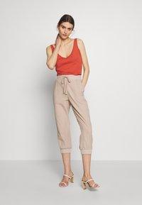 Kaffe - NAYA CAPRI - Trousers - cobblestone - 1