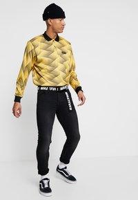 Kaotiko - Polo shirt - yellow - 1