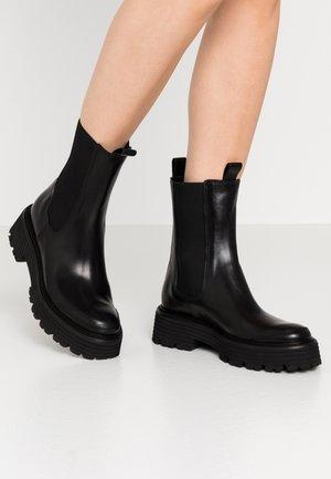 POWER - Kotníkové boty na platformě - schwarz