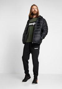 Kempa - PUFFER HOOD JACKET - Outdoor jakke - schwarz - 1