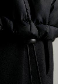 Kempa - PUFFER HOOD JACKET - Outdoor jakke - schwarz - 6