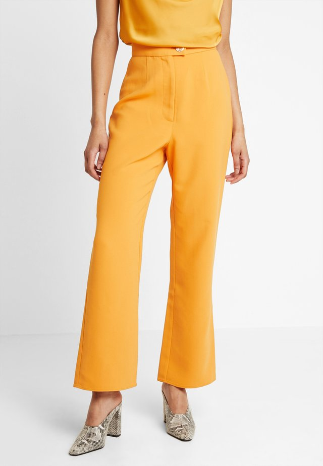 FOLLOWER PANT - Trousers - orange