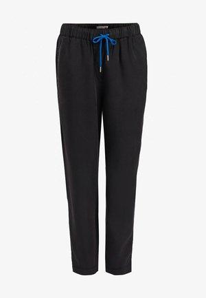 EVANGELIA - Pantaloni sportivi - black