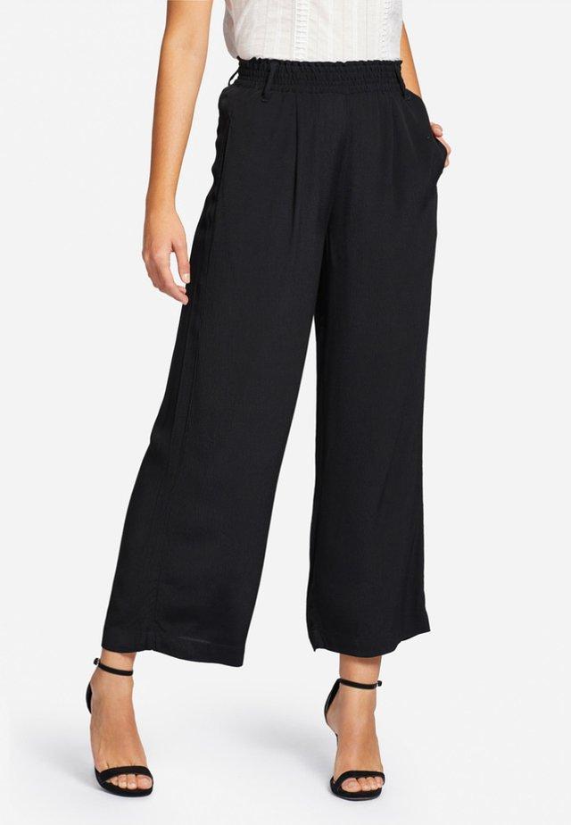 CARENE - Pantaloni - black