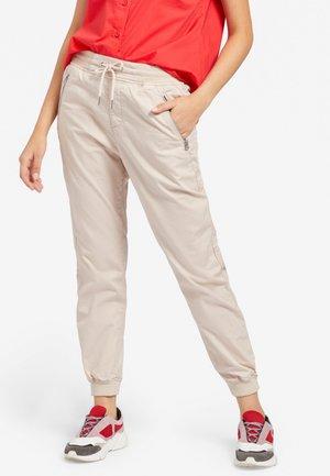 NATHALIA - Trousers - beige