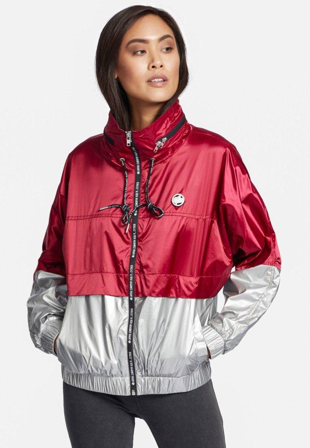 NABILA - Training jacket - red