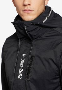khujo - IMRAN - Impermeable - black