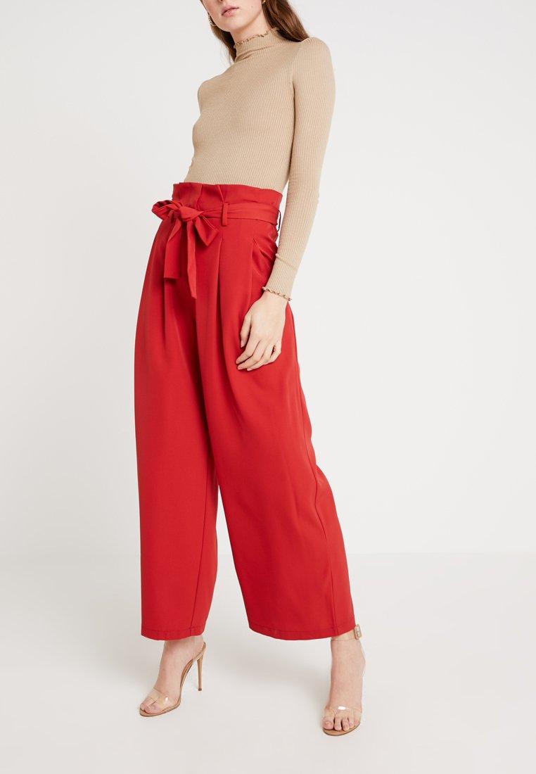 KIOMI TALL - Trousers - light red