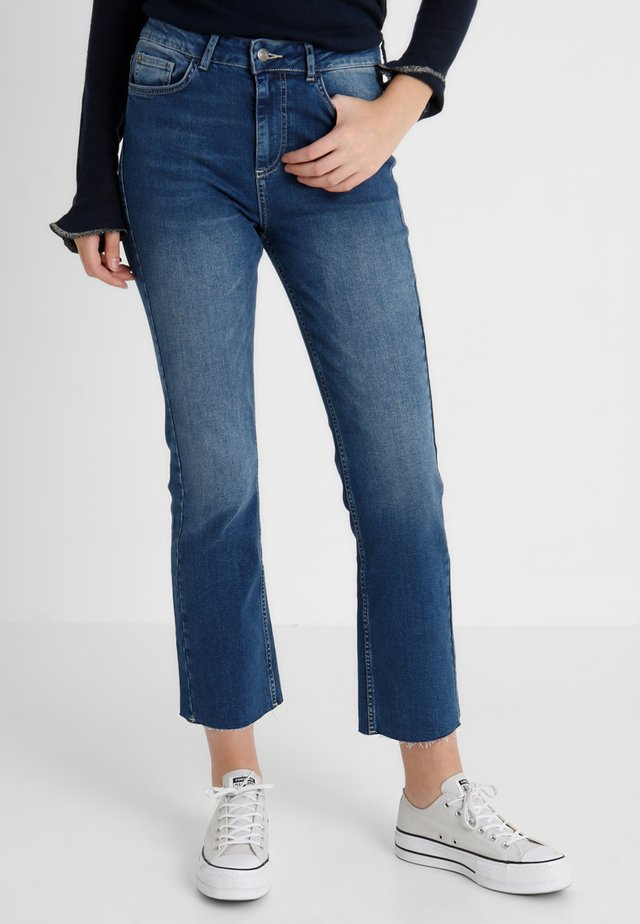 Straight leg jeans - mid blue denim