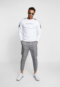 Kings Will Dream - FLICK CHECK - Trousers - black - 1