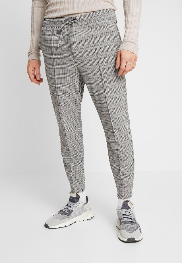 GALDO SMART CHECK - Trousers - black / white