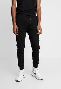 Kings Will Dream - GROCKTON JOGGERS  - Pantalon de survêtement - black - 0