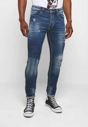 BERLIN CARROT JEANS - Slim fit jeans - blue