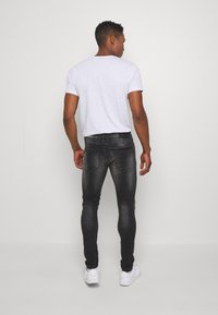 Kings Will Dream - LIMER CARROT - Slim fit jeans - grey/black - 2