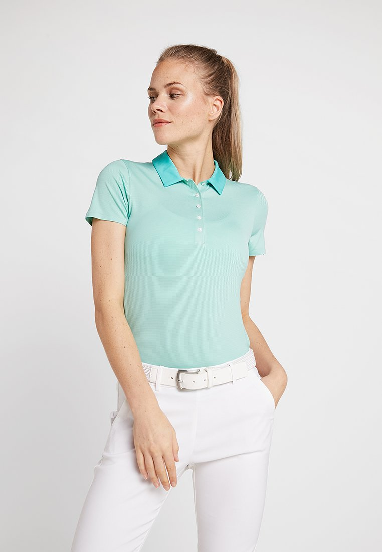 Kjus - WOMEN SINA  - Sports shirt - paradise green
