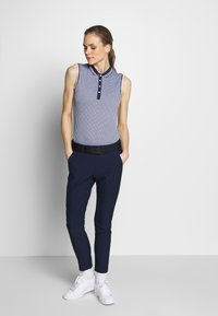 Kjus - WOMEN ELLA STRUCTURE - Polo shirt - atlanta blue/white - 1