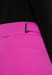 Kjus - WOMEN FORMULA PANTS - Zimní kalhoty - fruity pink - 3