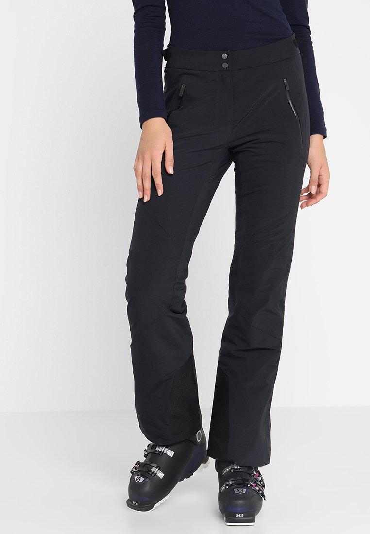 Kjus - WOMEN FORMULA PANTS - Täckbyxor - black