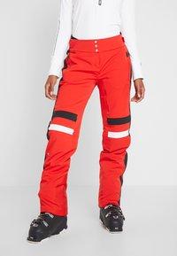 Kjus - WOMEN MADRISA PANTS - Täckbyxor - fiery red/black - 0