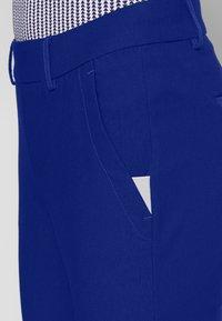 Kjus - WOMEN IKALA 7/8 TREGGINGS - Trousers - atlanta blue - 4