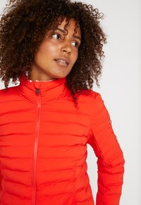 Kjus - WOMEN VIVANDA JACKET - Ski jacket - fiery red - 4