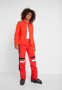 Kjus - WOMEN VIVANDA JACKET - Ski jacket - fiery red - 1