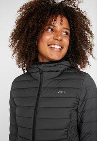 Kjus - MACUNA HOODED - Ski jacket - black - 4