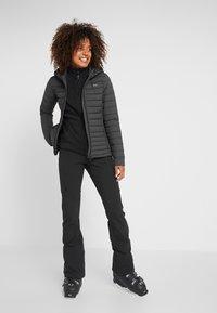 Kjus - MACUNA HOODED - Ski jacket - black - 1
