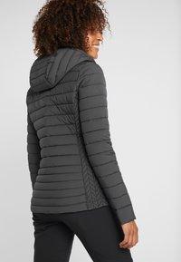 Kjus - MACUNA HOODED - Ski jacket - black - 2