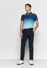 Kjus - MEN SPOT PRINTED - Polo shirt - ice blue - 1