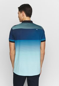 Kjus - MEN SPOT PRINTED - Polo shirt - ice blue - 2
