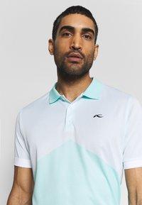 Kjus - MEN ARROW - Polo shirt - ice blue/white - 4
