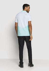 Kjus - MEN ARROW - Polo shirt - ice blue/white - 2