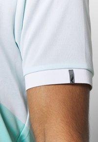 Kjus - MEN ARROW - Polo shirt - ice blue/white - 6