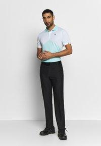 Kjus - MEN ARROW - Polo shirt - ice blue/white - 1