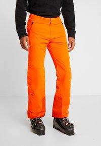 Kjus - MEN FORMULA PANTS - Pantalon de ski - orange - 0