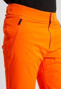 Kjus - MEN FORMULA PANTS - Pantalon de ski - orange - 6