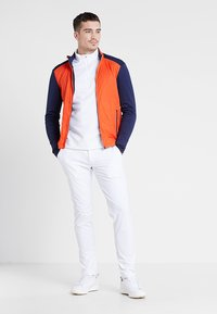 Kjus - MEN RETENTION JACKET - Outdoorová bunda - orange/blue - 1