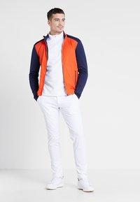 Kjus - MEN RETENTION JACKET - Blouson - orange/blue - 1