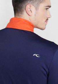 Kjus - MEN RETENTION JACKET - Blouson - orange/blue - 4